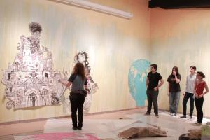 Swoon art in gallery with people 3