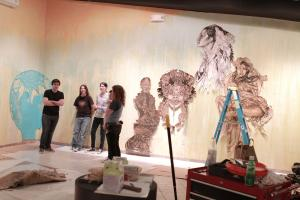 Swoon art in gallery with people 4