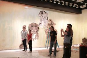 Swoon art in gallery with people 2