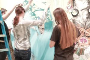 Swoon art in gallery with people 15