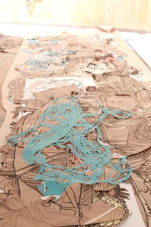 Swoon art in gallery with people 11
