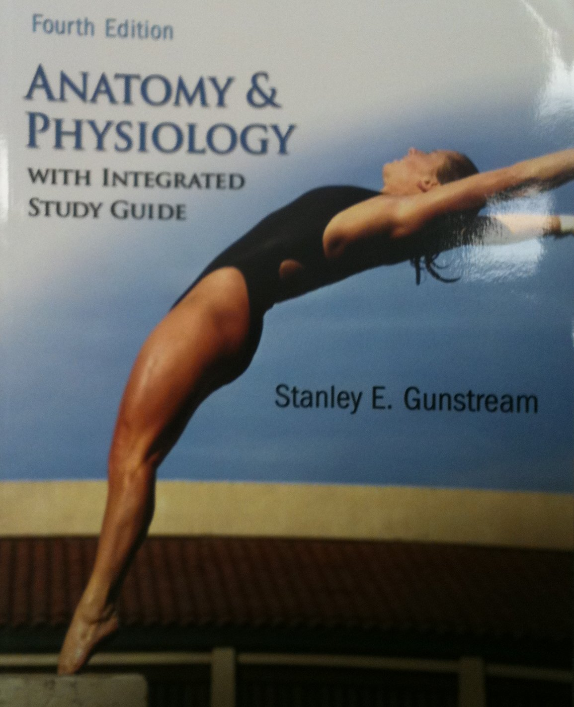 Front of Textbook: Woman diving into a swimming pool